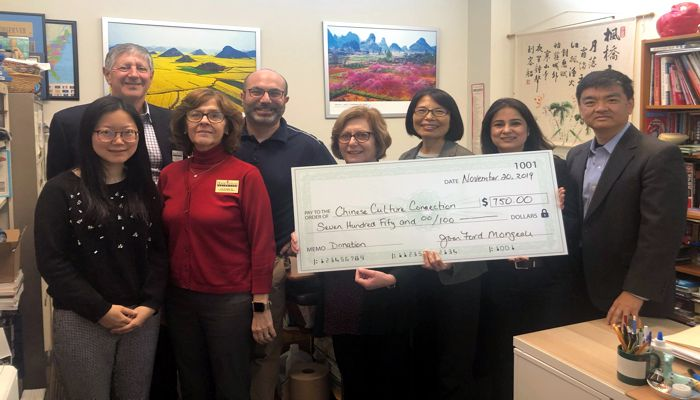 Malden Chamber of Commerce says we are thrilled to be able to donate a portion of our proceeds from SuperBowl IV to the Chinese Culture Connection. Along with representatives from their organization are also Lisa O'Loughlin and Gregg Ellenberg, Chamber Board members and Chamber Director, Joan Ford Mongeau.