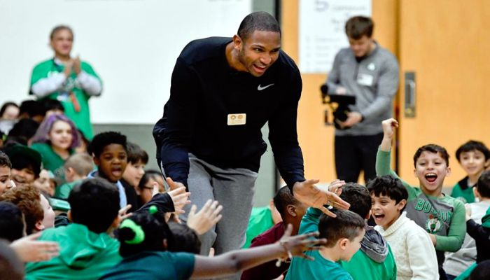 Boston Celtics player Al Horford high fives the students during a presentation by the Celtics Dunk Team at the Beebe School on Tuesday January 15, 2019