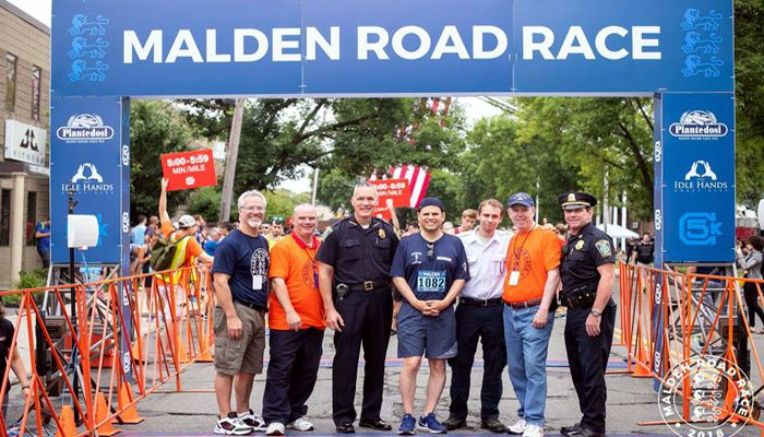 "Mayor Christenson says ""As I continue to recover from my first ever 10K Road Race, I want to thank organizers Ed O'Connor and Brittany Trimble for putting on a great event for our city as well as the 1,500 runners who helped raise $10,000 for our new World War I Memorial"""