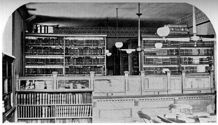 The Malden Public Library began in one small room in the old Town Hall, formerly occupied by Murray & Wiley, Dry Goods Store; before moving to the Converse Memorial Building in 1885.  This Image: Malden Public Library in Old Town Hall Building (1879-1885)