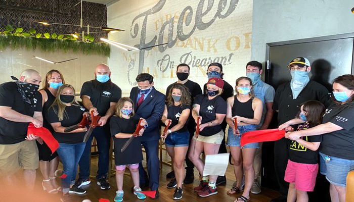 Mayor Christenson says Not only do I want to congratulate Faces Brewing on it's ribbon cutting ceremony but I also want to thank them for creating a place that is classy, fun and full of history from the former First National Bank!